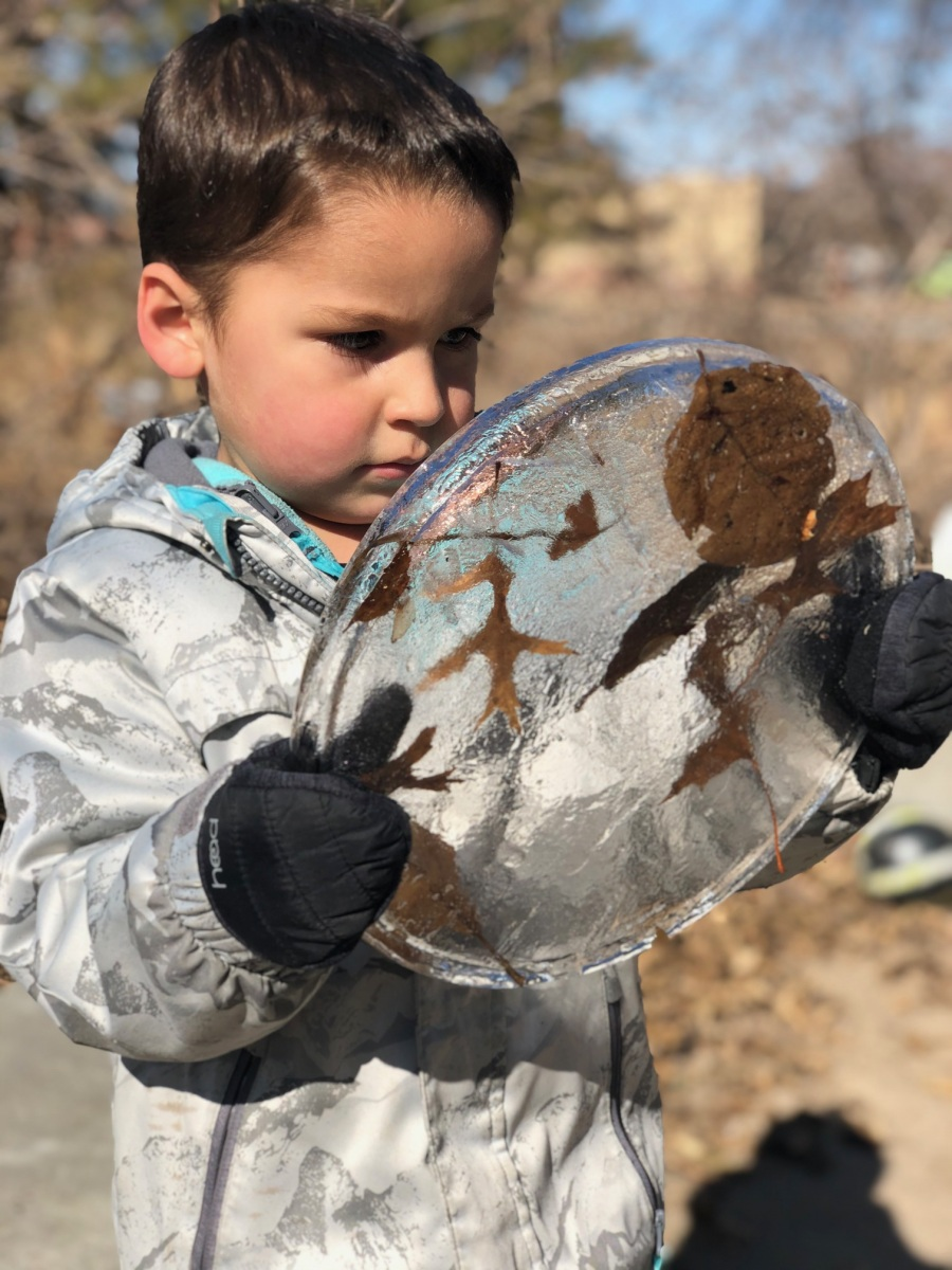 child with cirlce of ice