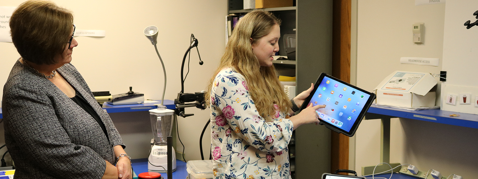 Kelly Woodworth, a speech-language pathology graduate student, demonstrates how an iPad might be used as an AAC device.