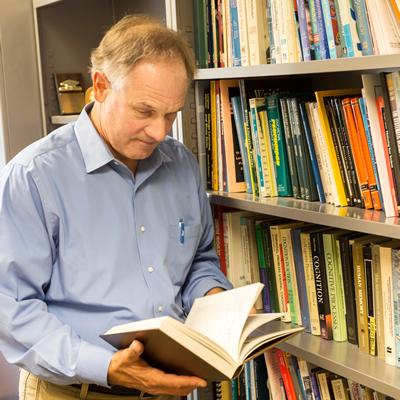 Dr, Kiewra at bookshelf
