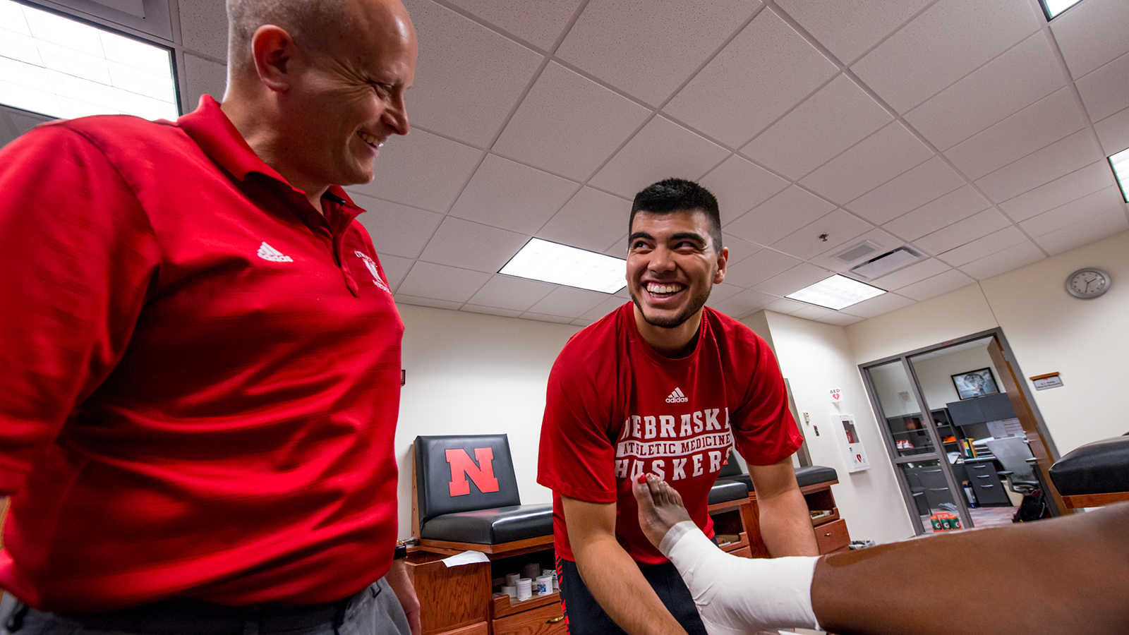 Dario receives feedback from his instructor in the Husker athletic training room.