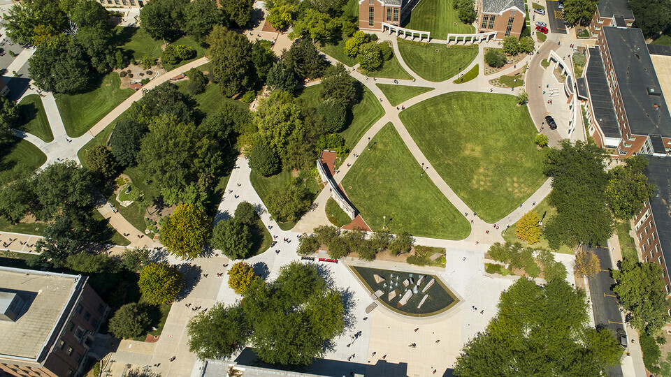 Aerial view of students walking across campus.