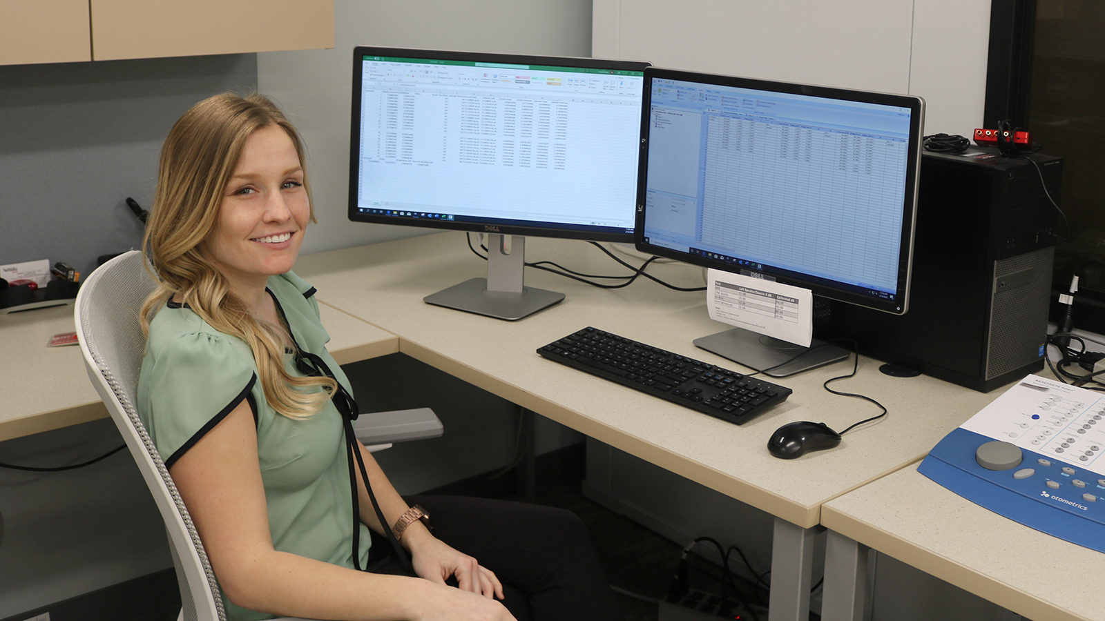 Elysa Binger analyzes data in the Cochlear Implant Research Lab.