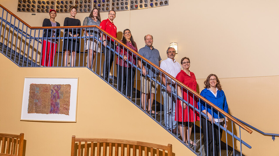 NOYCE Grant team members lined up on the stairs in Teachers College Hall.