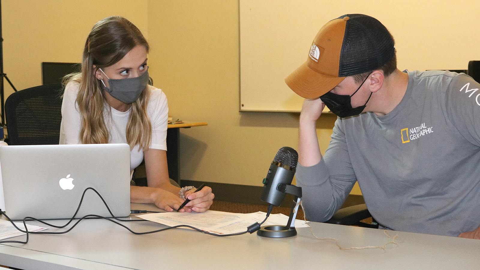 A Husker speech-language pathology graduate student explains voice screening results to a student from the Johnny Carson School of Theatre and Film.