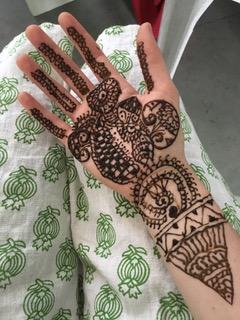 Kara Cruickshank learned about marriage customs as Anubhuti teachers drew Mendhi on her hands.
