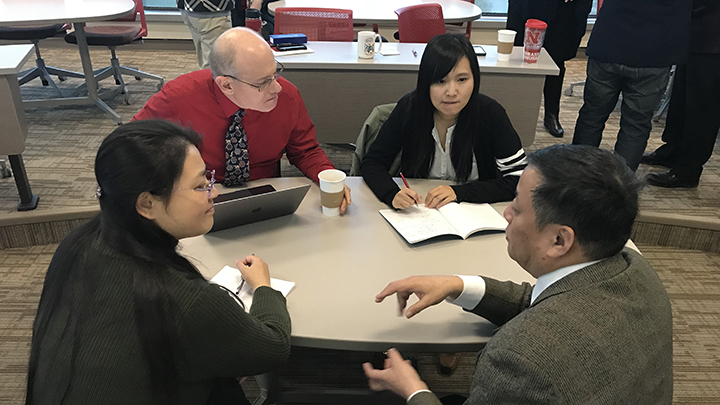 Guy Trainin (back left), TLTE professor and graduate chair, meets with his doctoral student Aiqing Yu (back right) and two faculty members from Beihang University: Jia Lu (front left) and Xiaoqi Zheng (front right), dean.