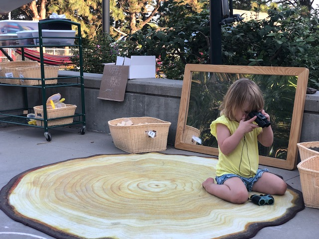 Child at Ruth Staples Lab learning outdoors.