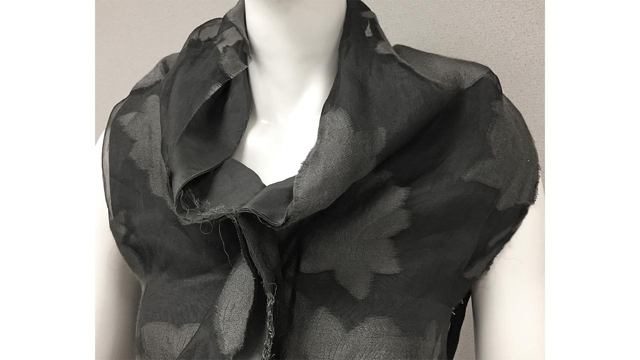 Gray deconstructed cowl neck dress, c. 2000 Label: Comme des Garcons, Designer: Rei Kawakubo