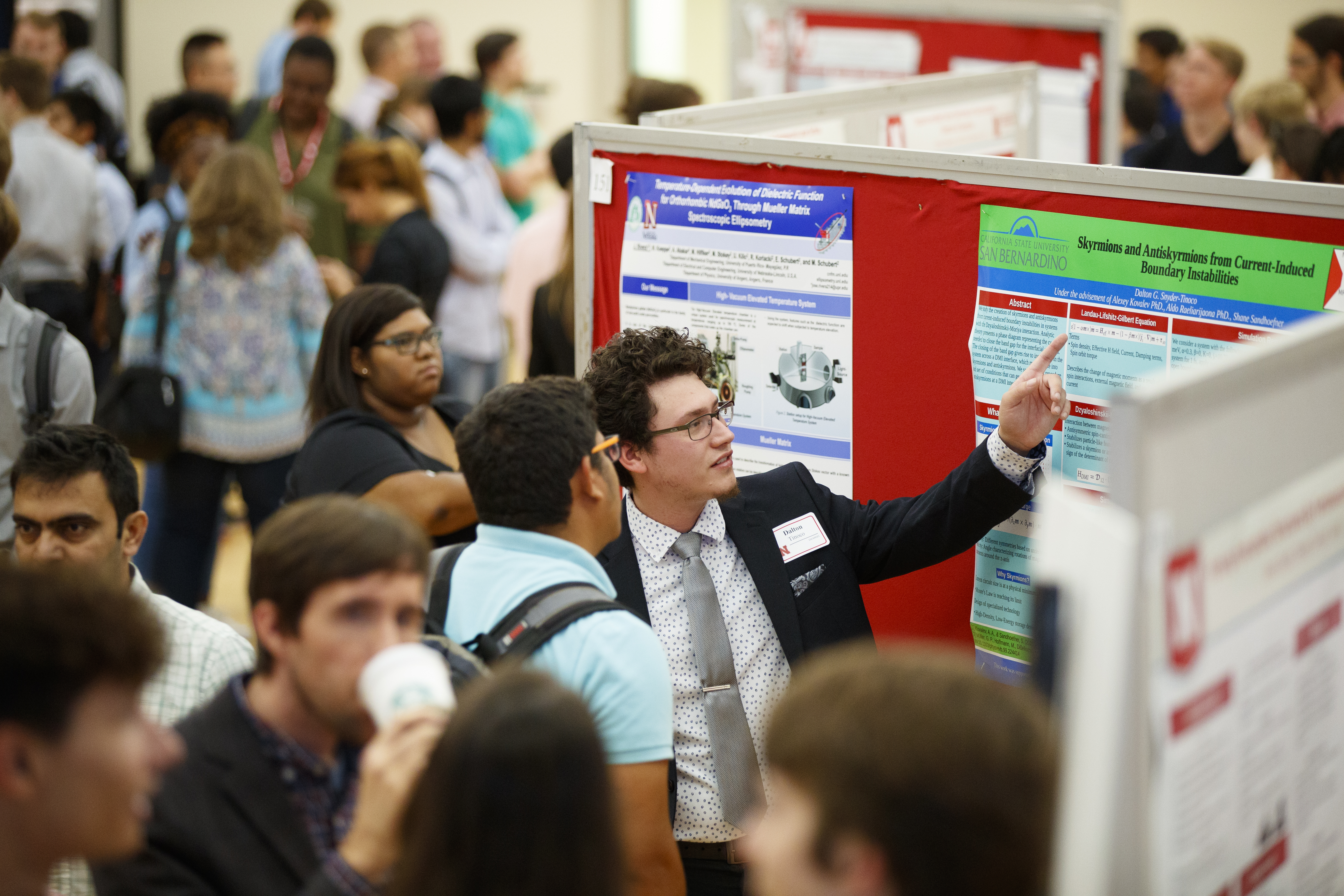 Students presenting at a research poster session.