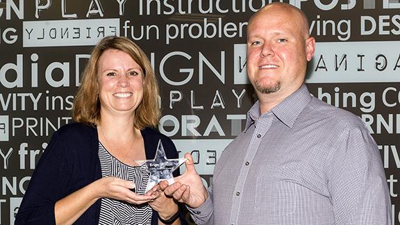 CEHS Staff Council President Nancy McConkey presents Brian Wilson with the August Staff Star Award.