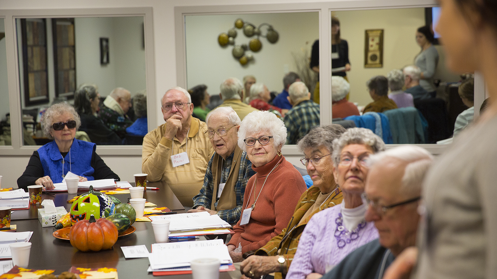 Photo of clinicians instructing senior citizens on memory tips