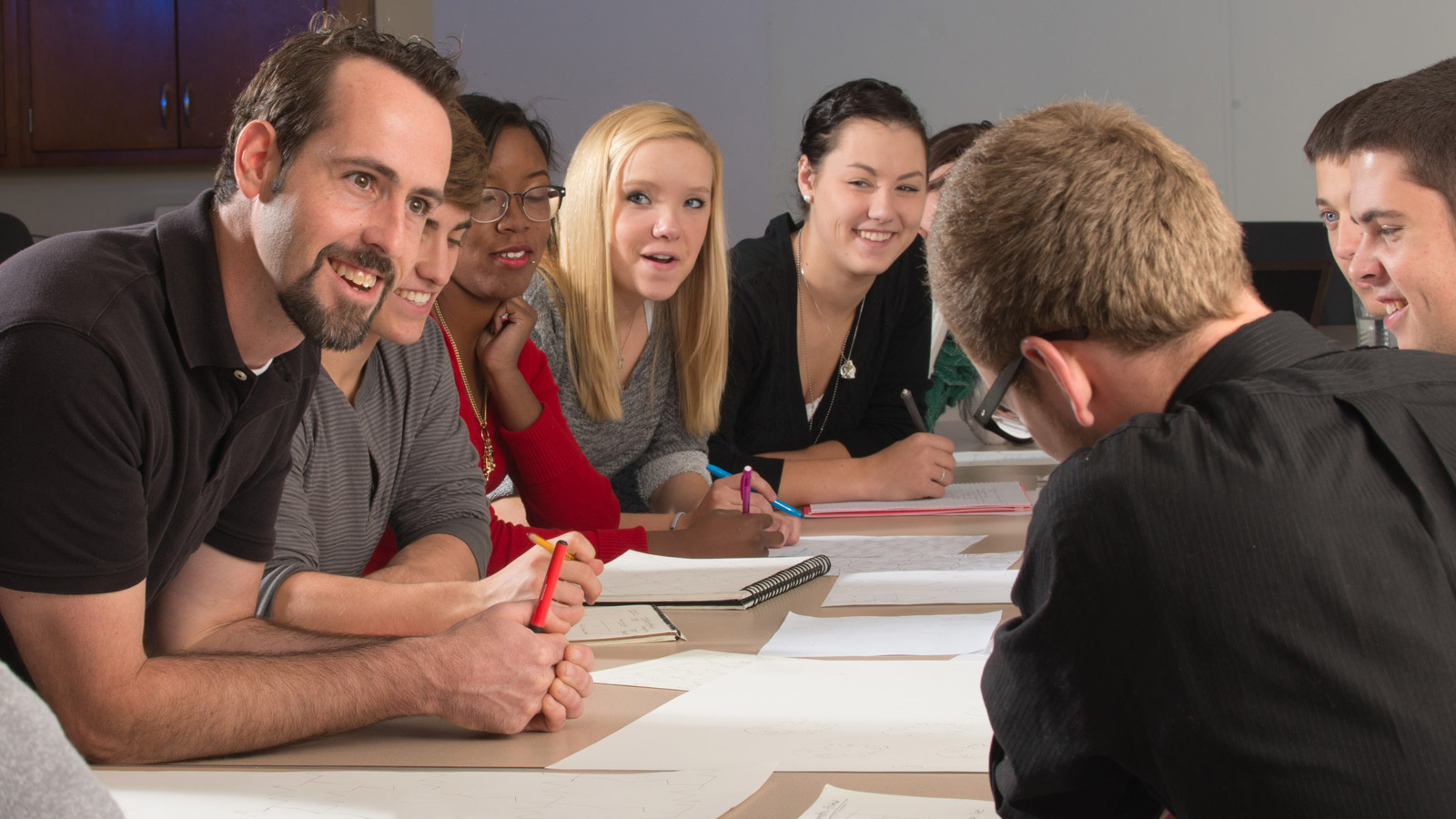 TMFD Faculty member Michael Burton and students