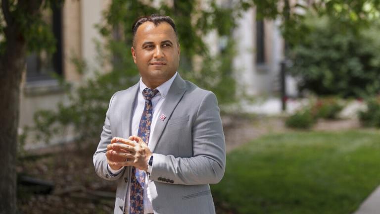 Falah Rashoka stands outside his office on East Campus.