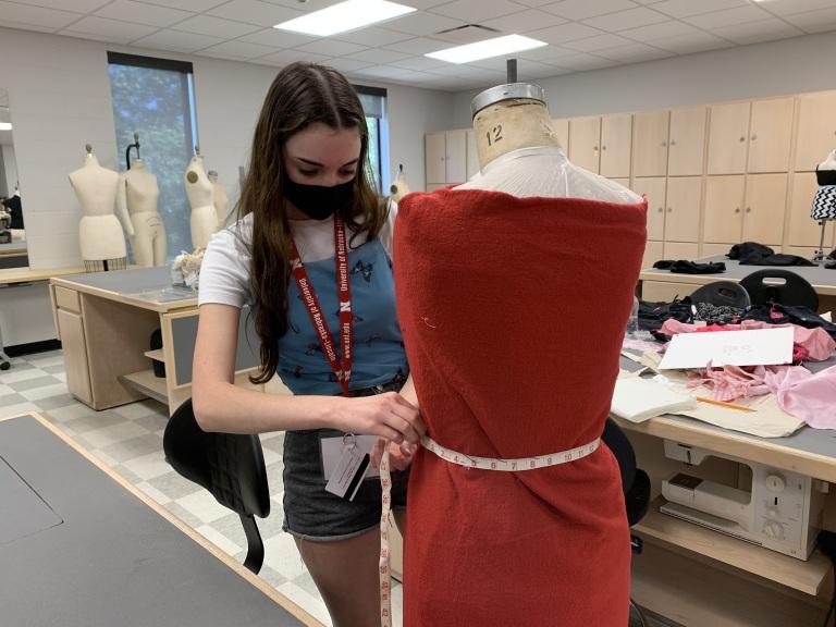 Student designing a fashion garment.