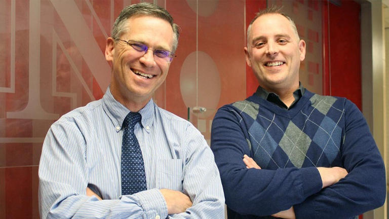 Richard Bischoff, chair of child, youth and family studies (left) and Paul Springer, associate professor, are partnering with international colleagues to apply their mental health model overseas. The model was developed in rural Nebraska communities.