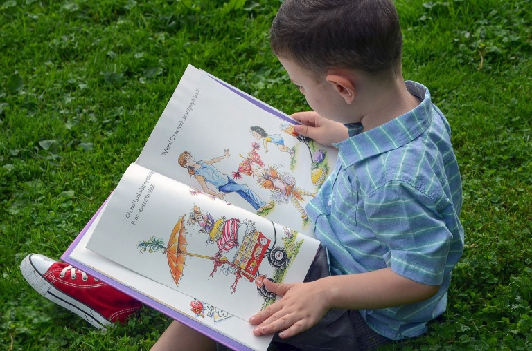 Child reading a story book.